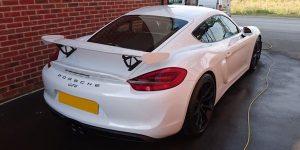White Porsche Cayman GT4 - valet in Littlehampton