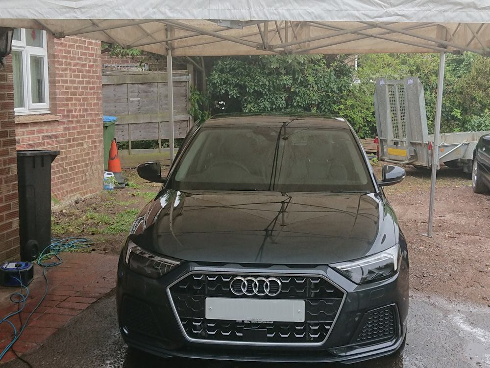 Audi A1 valeting under canopy in the rain