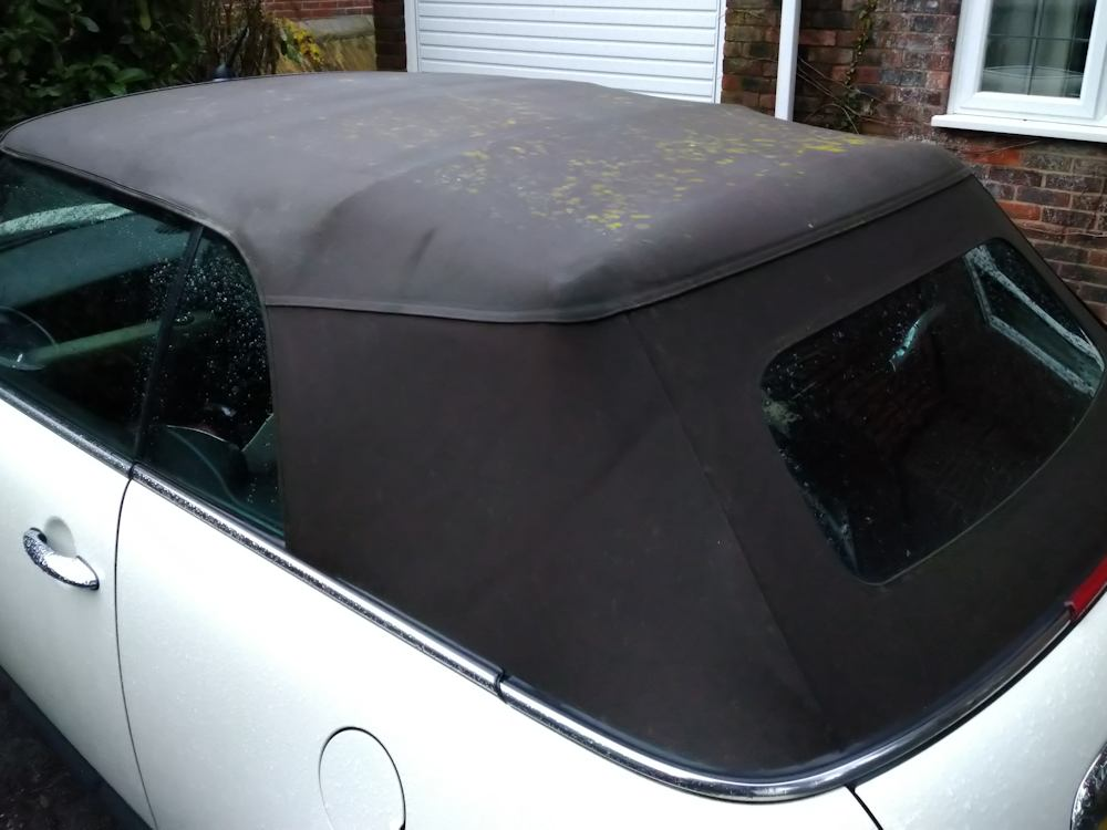 Mini convertible roof before deep clean and reproof