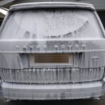 Very dirty Range Rover Vogue covered in snow foam